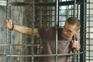 depositphotos_53510221-stock-photo-man-in-cage